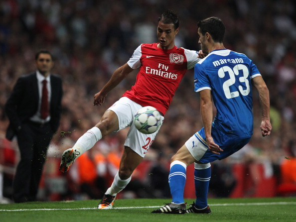 LONDON, ENGLAND - SEPTEMBER 28:  Marouane Chamakh of Arsenal  takes on Ivan Marcano of Olympiacos during the UEFA Champions League Group F match between Arsenal and Olympiacos at the Emirates Stadium on September 28, 2011 in London, England.  (Photo by Clive Rose/Getty Images)