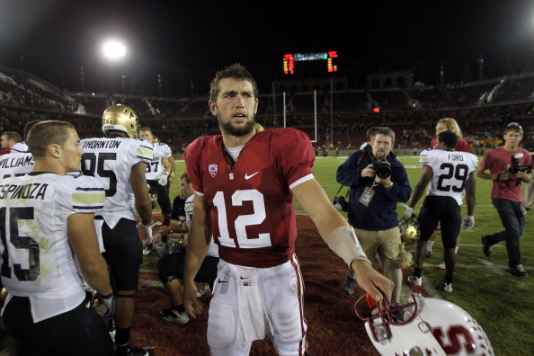 STANFORD, CA - OCTOBER 08:  Andrew Luck #12 of the Stanford Cardinal shakes hands with players from the Colorado Buffaloes after their game at Stanford Stadium on October 8, 2011 in Stanford, California.  (Photo by Ezra Shaw/Getty Images)