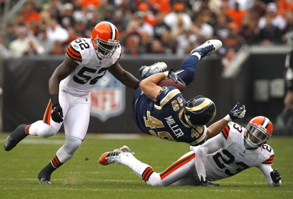 CLEVELAND, OH - NOVEMBER 13:  Fullback Brit Miller #49 of the St. Louis Rams is hit by defenders D'Qwell Jackson #52 and Joe Haden #23 of the Cleveland Browns at Cleveland Browns Stadium on November 13, 2011 in Cleveland, Ohio.  (Photo by Matt Sullivan/Getty Images)