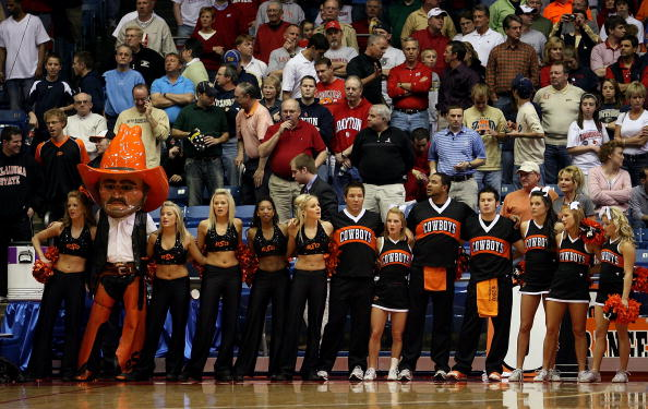 DAYTON, OH - MARCH 22: The mascot, dancers and cheerleaders of the Oklahoma State Cowboys stand on the sidelines during a game against the Pittsburgh Panthers during the second round of the NCAA Division I Men's Basketball Tournament at the University of Dayton Arena on March 22, 2009 in Dayton, Ohio.  (Photo by Andy Lyons/Getty Images)