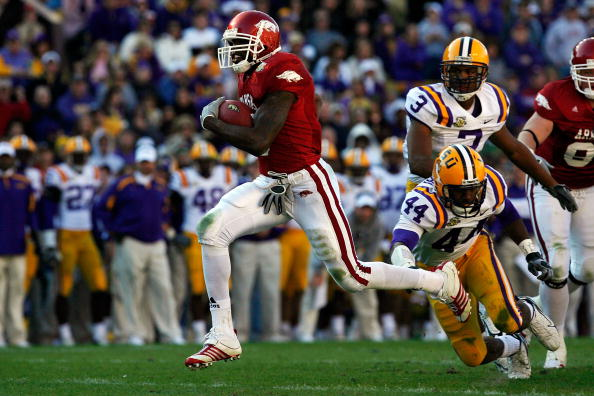 BATON ROUGE, LA - NOVEMBER 23:  Darren McFadden #5 of the Arkansas Razorbacks runs past Danny McCray #44 of the Louisiana State University Tigers to score a touchdown on November 23, 2007 at Tiger Stadium in Baton Rouge, Louisiana.  (Photo by Chris Graythen/Getty Images)