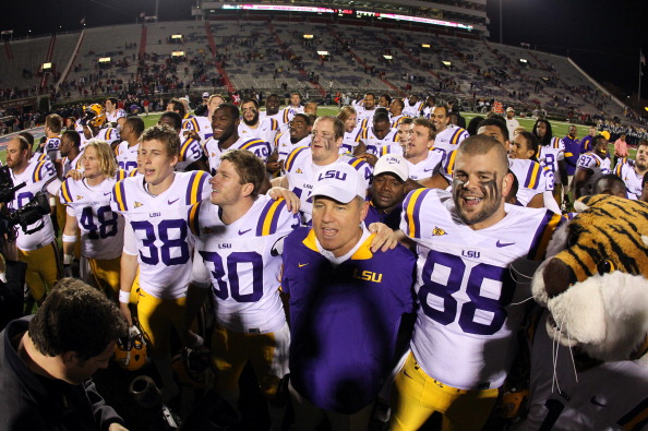 OXFORD, MS - NOVEMBER 19: Les Miles, head coach of the LSU Tigers, sings the LSU school song with Drew Alleman #30 and Chase Clement #88 after defeating the Ole Miss Rebels on November 19, 2011 at Vaught-Hemingway Stadium in Oxford, Mississippi. LSU beat Mississippi 52-3. (Photo by Joe Murphy/Getty Images)