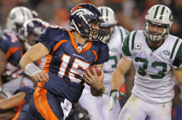 DENVER, CO - NOVEMBER 17:  Quarterback Tim Tebow #15 of the Denver Broncos rushes against Eric Smith #33 of the New York Jets at Sports Authority Field at Mile High on November 17, 2011 in Denver, Colorado. The Broncos defeated the Jets 17-13.  (Photo by Doug Pensinger/Getty Images)