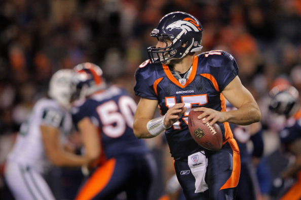 DENVER, CO - NOVEMBER 17:  Quarterback Tim Tebow #15 of the Denver Broncos rolls out against the New York Jets at Sports Authority Field at Mile High on November 17, 2011 in Denver, Colorado. Tebow went on to score the game winning touchdown as the Broncos defeated the Jets 17-13.  (Photo by Doug Pensinger/Getty Images)