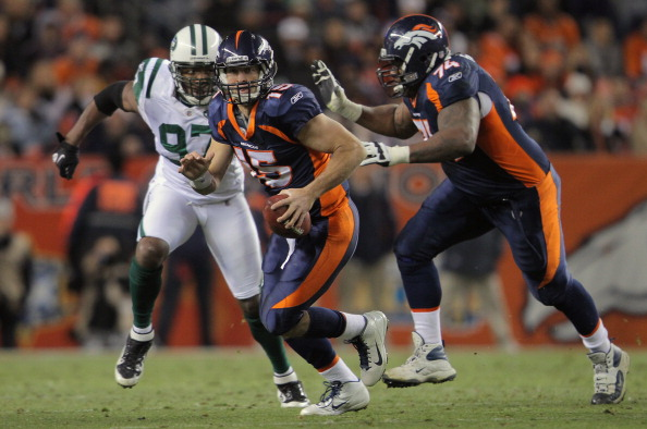 DENVER, CO - NOVEMBER 17:  Quarterback Tim Tebow #15 of the Denver Broncos scrambles with the ball as Orlando Franklin #74 of the Denver Broncos blocks against Calvin Pace #97 of the New York Jets at Sports Authority Field at Mile High on November 17, 2011 in Denver, Colorado. The Broncos defeated the Jets 17-13.  (Photo by Doug Pensinger/Getty Images)