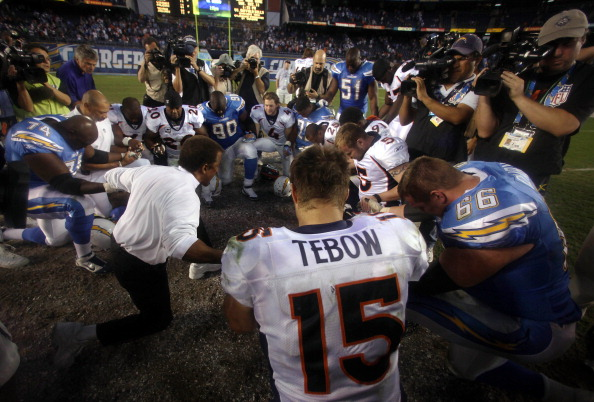 SAN DIEGO, CA - NOVEMBER 27:  Quarterback Tim Tebow #15 of the Denver Broncos prays in the middle of the field with other players during the Broncos 16-13 overtime win over the San Diego Chargers in their NFL Game on November 27, 2011 at Qualcomm Stadium in San Diego, California  (Photo by Donald Miralle/Getty Images)