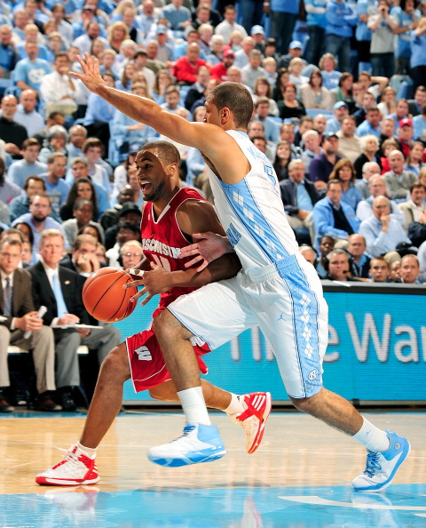 CHAPEL HILL, NC - NOVEMBER 30:  Kendall Marshall #5 of the North Carolina Tar Heels defends Jordan Taylor #11 of the Wisconsin Badgers during play at the Dean Smith Center on November 30, 2011 in Chapel Hill, North Carolina.  (Photo by Grant Halverson/Getty Images)