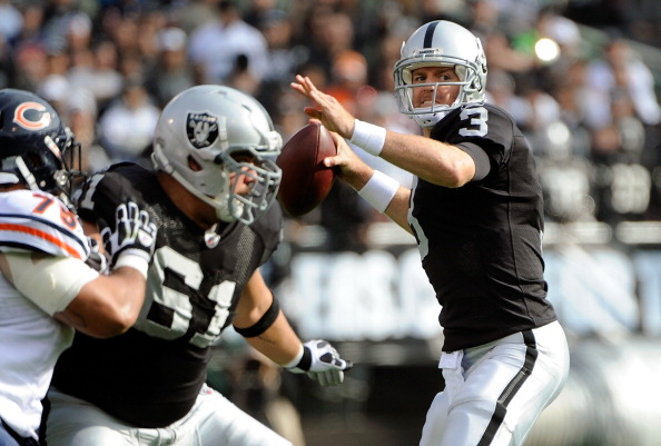 OAKLAND, CA - NOVEMBER 27:  Carson Palmer #3 of the Oakland Raiders drops back to pass against the Chicago Bears at O.co Coliseum on November 27, 2011 in Oakland, California.  (Photo by Thearon W. Henderson/Getty Images)