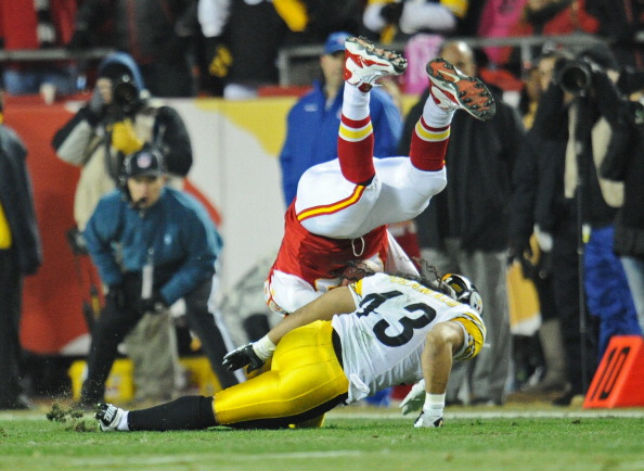 KANSAS CITY, MO - NOVEMBER 27:  Strong safety Troy Polamalu #43 of the Pittsburgh Steelers goes down with a head injury after making a tackle on offensive tackle Steve Maneri #68 of the Kansas City Chiefs during the first quarter on November 27, 2011 at Arrowhead Stadium in Kansas City, Missouri.  Pittsburgh defeated Kansas City 13-9.  (Photo by Peter Aiken/Getty Images)