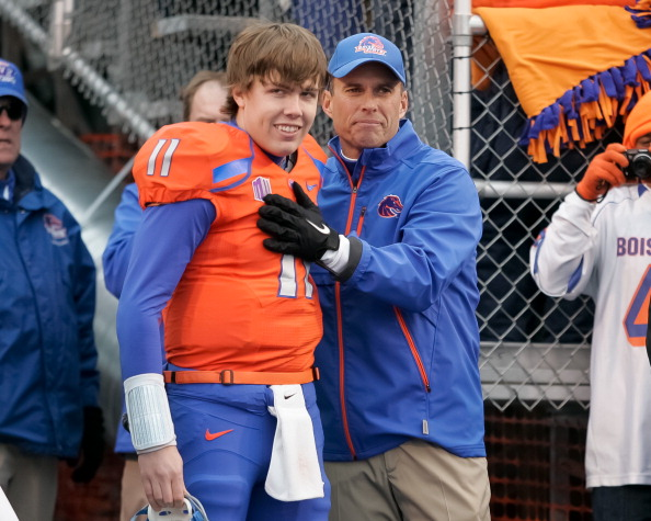 BOISE, ID - DECEMBER 03: Head Coach Chris Petersen congratulates Kellen Moore #11 of the Boise State Broncos before his Senior Day introduction before the game against the New Mexico Lobos at Bronco Stadium on December 3, 2011 in Boise, Idaho.  (Photo by Otto Kitsinger III/Getty Images)
