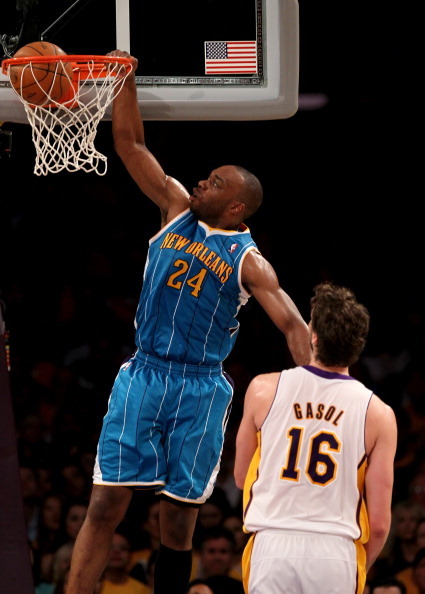 LOS ANGELES, CA - APRIL 17:  Carl Landry #24 of  the New Orleans Hornets dunks over Pau Gasol #16 of the Los Angeles Lakers in Game One of the Western Conference Quarterfinals in the 2011 NBA Playoffs on April 17, 2011 at Staples Center in Los Angeles, California. The Hornets won 109-100.  NOTE TO USER: User expressly acknowledges and agrees that, by downloading and or using this photograph, User is consenting to the terms and conditions of the Getty Images License Agreement.  (Photo by Stephen Dunn/Getty Images)
