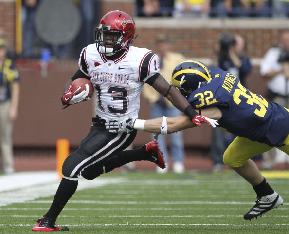 ANN ARBOR, MI - SEPTEMBER 24: Ronnie Hillman #13 of San Diego State runs for a first down as Jordan Kovacs #32 of the Michigan Wolverines attempts to make the stop runs during the first half of the game at Michigan Stadium on September 24, 2011 in Ann Arbor, Michigan.  (Photo by Leon Halip/Getty Images)