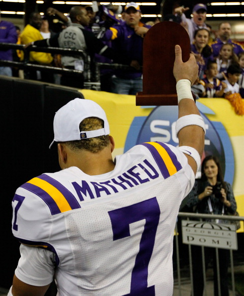 ATLANTA, GA - DECEMBER 03:  Tyrann Mathieu #7 of the LSU Tigers walks off thye field after earning the MVP trophy in their 42-10 win over the Georgia Bulldogs during the 2011 SEC Championship Game at Georgia Dome on December 3, 2011 in Atlanta, Georgia.  (Photo by Kevin C. Cox/Getty Images)
