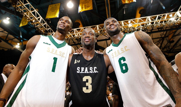 MIAMI, FL - OCTOBER 08:  Chris Bosh, Dwyane Wade, and LeBron James address the fans during the South Florida All Star Classic at Florida International University on October 8, 2011 in Miami, Florida.  (Photo by Mike Ehrmann/Getty Images)