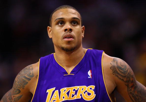 PHOENIX - DECEMBER 28:  Shannon Brown #12 of the Los Angeles Lakers in action during the NBA game against the Phoenix Suns at US Airways Center on December 28, 2009 in Phoenix, Arizona.  The Suns defeated the Lakers 118-103. NOTE TO USER: User expressly acknowledges and agrees that, by downloading and or using this photograph, User is consenting to the terms and conditions of the Getty Images License Agreement.  (Photo by Christian Petersen/Getty Images)