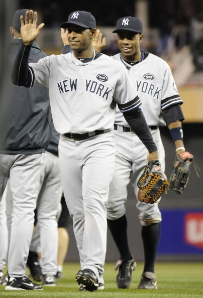 MINNEAPOLIS, MN - OCTOBER 6: Greg Golson #27 and Curtis Granderson #14 of the New York Yankees celebrate a 6-4 win against the Minnesota Twins following game one of the ALDS on October 6, 2010 at Target Field in Minneapolis, Minnesota. (Photo by Hannah Foslien/Getty Images)