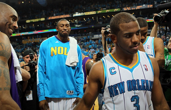 NEW ORLEANS, LA - APRIL 28:  Chris Paul #3 of the New Orleans Hornets walks off the court after a 98-80 loss as Kobe Bryant #24 of the Los Angeles Lakers smiles after winning the series in Game Six of the Western Conference Quarterfinals in the 2011 NBA Playoffs on April 28, 2011 at New Orleans Arena in New Orleans, Louisiana.  NOTE TO USER: User expressly acknowledges and agrees that, by downloading and or using this photograph, User is consenting to the terms and conditions of the Getty Images License Agreement.  (Photo by Ronald Martinez/Getty Images)