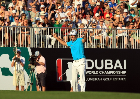 DUBAI, UNITED ARAB EMIRATES - DECEMBER 09:  Alvaro Quiros of Spain celebrates holing an eagle putt at the par 5, 18th hole on his way to an eight under par round of 64 and a four shot lead at the conclusion of the second round of the Dubai World Championship on the Earth Course at the Jumeirah Golf Estates on December 9, 2011 in Dubai, United Arab Emirates.  (Photo by David Cannon/Getty Images)