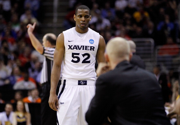 CLEVELAND, OH - MARCH 18: Tu Holloway #52 of the Xavier Musketeers walks to the bench late in the second half against the Marquette Golden Eagles during the second round of the 2011 NCAA men's basketball tournament at Quicken Loans Arena on March 18, 2011 in Cleveland, Ohio.  (Photo by Gregory Shamus/Getty Images)