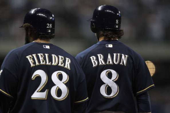MILWAUKEE, WI - OCTOBER 10:  (L-R) Prince Fielder #28 and Ryan Braun #8 of the Milwaukee Brewers stand on the field against the St. Louis Cardinals during Game Two of the National League Championship Series at Miller Park on October 10, 2011 in Milwaukee, Wisconsin. The Cardinals won 12-3. (Photo by Jonathan Daniel/Getty Images)