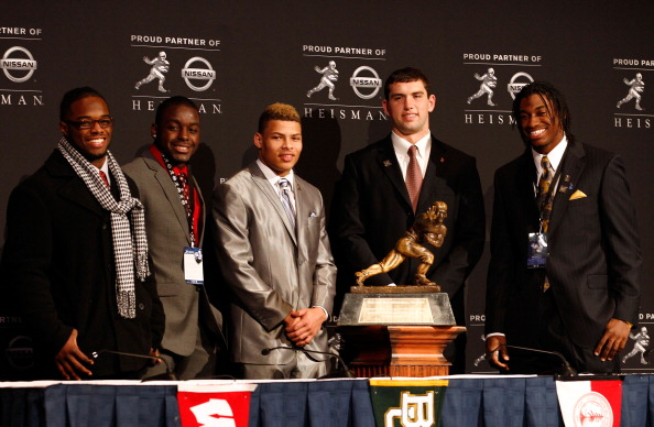 NEW YORK, NY - DECEMBER 10:  (L-R) Heisman Trophy finalists running back Trent Richardson of the Alabama Crimson Tide, running back Montee Ball of the Wisconsin Badgers, cornerback Tyrann Mathieu of the LSU Tigers, Andrew Luck of the Stanford University Cardinal and quarterback Robert Griffin III of the Baylor Bears pose with the Heisman Trophy after a press conference at The New York Marriott Marquis on December 10, 2011 in New York City.  (Photo by Jeff Zelevansky/Getty Images)