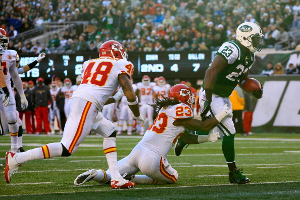 EAST RUTHERFORD, NJ - DECEMBER 11:  Shonn Greene #23 of the New York Jets scores a touchdown infront of Reshard Langford #48 of the Kansas City Chiefs at MetLife Stadium on December 11, 2011 in East Rutherford, New Jersey.  (Photo by Chris Trotman/Getty Images)