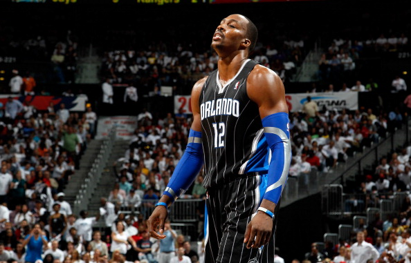 ATLANTA, GA - APRIL 28:  Dwight Howard #12 of the Orlando Magic walks to the bench after a turnover to the Atlanta Hawks during Game Six of the Eastern Conference Quarterfinals in the 2011 NBA Playoffs at Philips Arena on April 28, 2011 in Atlanta, Georgia.  NOTE TO USER: User expressly acknowledges and agrees that, by downloading and or using this photograph, User is consenting to the terms and conditions of the Getty Images License Agreement.  (Photo by Kevin C. Cox/Getty Images)