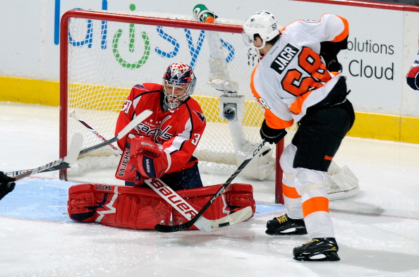 WASHINGTON, DC - DECEMBER 13:  Michal Neuvirth #30 of the Washington Capitals makes a save against Jamomir Jagr #68 of the Philadelphia Flyers at the Verizon Center on December 13, 2011 in Washington, DC.  (Photo by Greg Fiume/Getty Images)