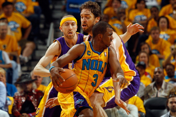 NEW ORLEANS, LA - APRIL 22:  Chris Paul #3 of the New Orleans Hornets drives the ball around Pau Gasol #16 of the Los Angeles Lakers in Game Three of the Western Conference Quarterfinals in the 2011 NBA Playoffs at the New Orleans Arena  on April 22, 2011 in New Orleans, Louisiana.  The Lakers defeated the Hornets 100-86.  NOTE TO USER: User expressly acknowledges and agrees that, by downloading and or using this photograph, User is consenting to the terms and conditions of the Getty Images License Agreement.  (Photo by Chris Graythen/Getty Images)