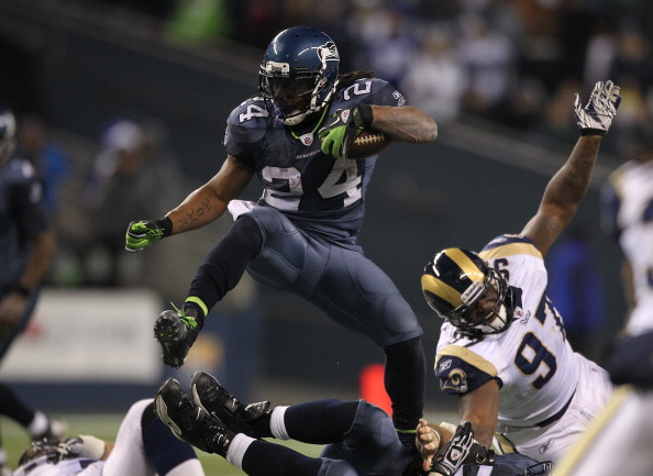 SEATTLE - DECEMBER 12:  Running back Marshawn Lynch #24 of the Seattle Seahawks rushes against Darell Scott #97 of the St. Louis Rams at CenturyLink Field on December 12, 2011 in Seattle, Washington. The Seahawks defeated the Rams 30-13. (Photo by Otto Greule Jr/Getty Images)