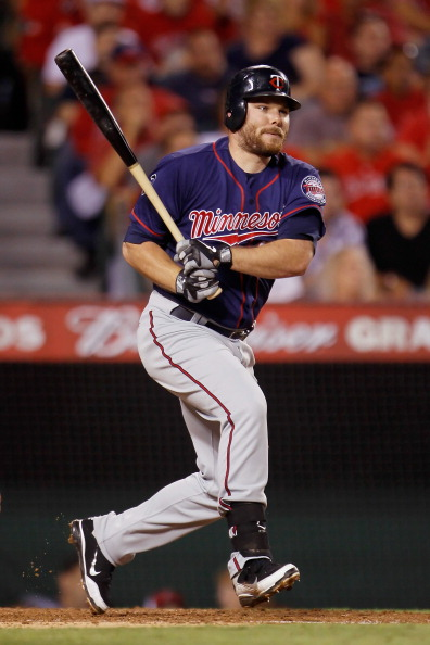 ANAHEIM, CA - SEPTEMBER 02:  Jason Kubel #16 of the Minnesota Twins hits an RBI single against the Los Angeles Angels of Anaheim in the sixth inning at Angel Stadium of Anaheim on September 2, 2011 in Anaheim, California.  (Photo by Jeff Gross/Getty Images)