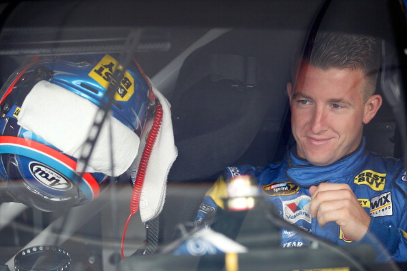 JOLIET, IL - SEPTEMBER 16:  A.J. Allmendinger, driver of the #43 Best Buy Ford, sits in his car in the garage during practice for the NASCAR Sprint Cup Series GEICO 400 at Chicagoland Speedway on September 16, 2011 in Joliet, Illinois.  (Photo by Todd Warshaw/Getty Images for NASCAR)