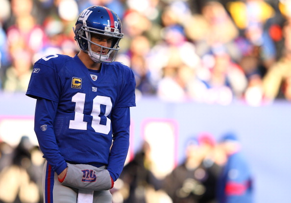 EAST RUTHERFORD, NJ - DECEMBER 18:   Eli Manning #10 of the New York Giants looks on against the Washington Redskins during their game at MetLife Stadium on December 18, 2011 in East Rutherford, New Jersey.  (Photo by Al Bello/Getty Images)