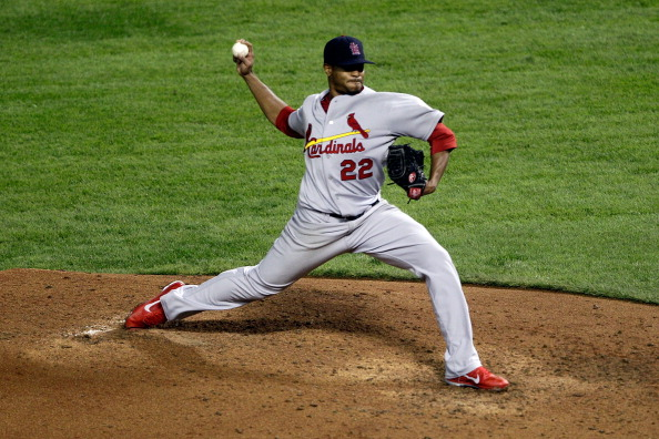 ARLINGTON, TX - OCTOBER 23: Edwin Jackson #22 of the St. Louis Cardinals pitches in the fifth inning during Game Four of the MLB World Series against the Texas Rangers at Rangers Ballpark in Arlington on October 23, 2011 in Arlington, Texas.  (Photo by Rob Carr/Getty Images)