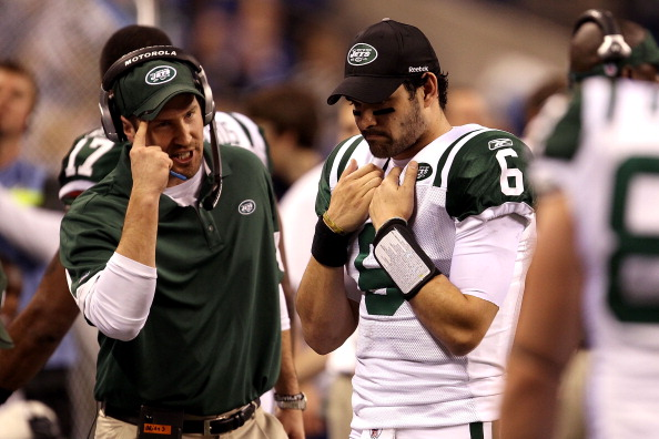 INDIANAPOLIS, IN - JANUARY 08:  Offensive coordinator Brian Schottenheimer of the New York Jets gestures as he talks to quarterback Mark Sanchez #6 late in the fourth quarter against the Indianapolis Colts during their 2011 AFC wild card playoff game at Lucas Oil Stadium on January 8, 2011 in Indianapolis, Indiana. The Jets won 17-16. (Photo by Jonathan Daniel/Getty Images)