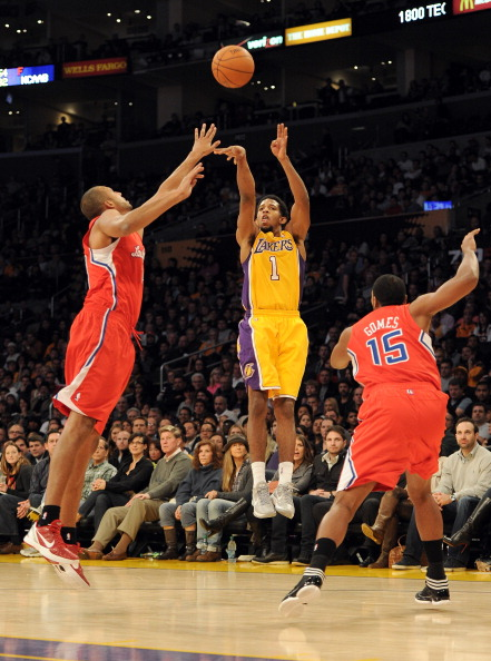 LOS ANGELES, CA - DECEMBER 19:  Darius Morris #1 of the Los Angeles Lakers shoots a last second three pointer in front of Brian Cook #34 and Ryan Gomes #15 of the Los Angeles Clippers during the first quarter at Staples Center on December 19, 2011 in Los Angeles, California.  (Photo by Harry How/Getty Images)
