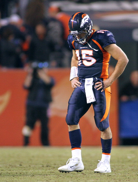 DENVER, CO - DECEMBER 18: Tim Tebow #15 of the Denver Broncos walks off the field with his head down in the closing moments against the New England Patriots on December 18, 2011 during the first half at Sports Authority Field at Mile High in Denver, Colorado. The New England Patriots won the game 41-23. (Photo by Marc Piscotty/Getty Images)