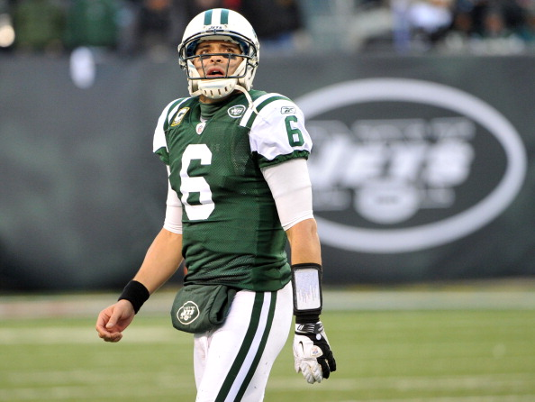 EAST RUTHERFORD, NJ - DECEMBER 24: Mark Sanchez #6 of the New York Jets reacts to the game action during the second half against the New York Giants on December 24, 2011 at MetLife Stadium in East Rutherford, New Jersey. (Photo by Christopher Pasatieri/Getty Images)