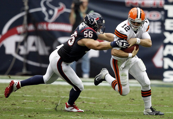 HOUSTON - NOVEMBER 06:  Quarterback Colt McCoy #12 of the Cleveland Browns is chased down by linebacker Brian Cushing #56 at Reliant Stadium on November 6, 2011 in Houston, Texas.  (Photo by Bob Levey/Getty Images)