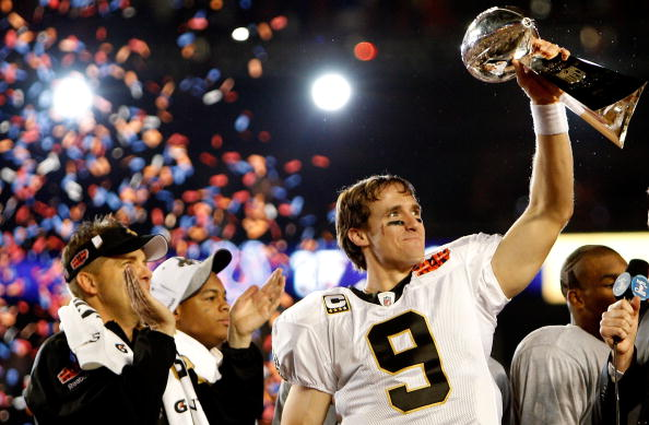 MIAMI GARDENS, FL - FEBRUARY 07:  Quarterback Drew Brees #9 of the New Orleans Saints celebrates with the Vince Lombardi Trophy after his team defeated the Indianapolis Colts during Super Bowl XLIV on February 7, 2010 at Sun Life Stadium in Miami Gardens, Florida.  (Photo by Chris Graythen/Getty Images)