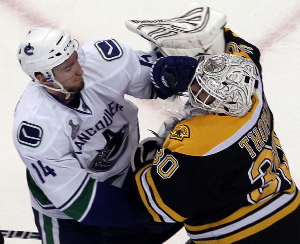 BOSTON, MA - JUNE 08:  Tim Thomas #30 of the Boston Bruins fights with Alex Burrows #14 of the Vancouver Canucks during Game Four of the 2011 NHL Stanley Cup Final at TD Garden on June 8, 2011 in Boston, Massachusetts.  (Photo by Jim Rogash/Getty Images)