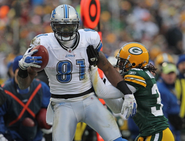 GREEN BAY, WI - JANUARY 01: Calvin Johnson #81 of the Detroit Lions breaks away from Tramon Williams #38 of the Green Bay Packers after catching a pass at Lambeau Field on January 1, 2012 in Green Bay, Wisconsin. The Packers defeated the Lions 45-41. (Photo by Jonathan Daniel/Getty Images)