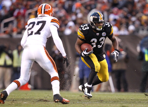 CLEVELAND, OH - JANUARY 01:  Running back Isaac Redman #33 of the Pittsburgh Steelers runs by Eric Hagg #27 of the Cleveland Browns at Cleveland Browns Stadium on January 1, 2012 in Cleveland, Ohio.  (Photo by Matt Sullivan/Getty Images)
