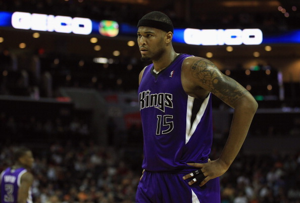 CHARLOTTE, NC - FEBRUARY 25:  DeMarcus Cousins #15 of the Sacramento Kings reacts to a call against the Charlotte Bobcats during their game at Time Warner Cable Arena on February 25, 2011 in Charlotte, North Carolina. NOTE TO USER: User expressly acknowledges and agrees that, by downloading and/or using this Photograph, User is consenting to the terms and conditions of the Getty Images License Agreement.  (Photo by Streeter Lecka/Getty Images)