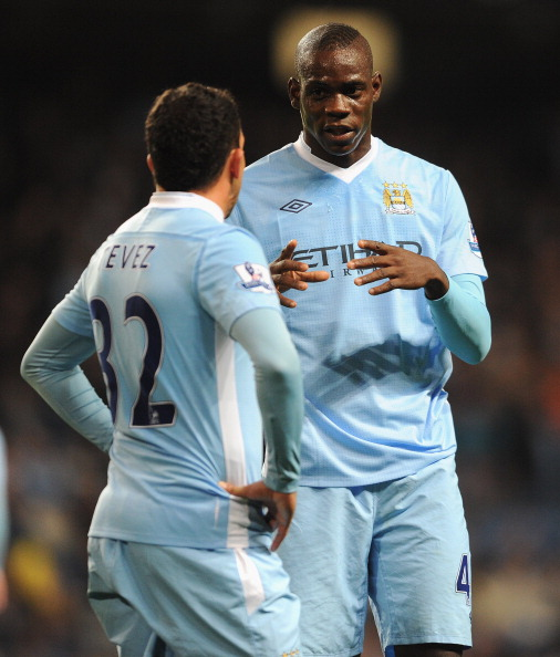 MANCHESTER, ENGLAND - SEPTEMBER 21:  Mario Balotelli of Manchester City speaks to team mate Carlos Tevez during the Carling Cup Third Round match between Manchester City and Birmingham City at the Etihad Stadium on September 21, 2011 in Manchester, England.  (Photo by Michael Regan/Getty Images)