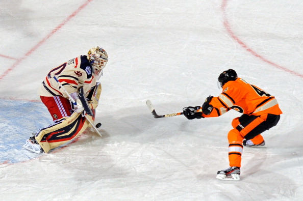 PHILADELPHIA, PA - JANUARY 02:  Henrik Lundqvist #30 of the New York Rangers makes a save on a penalty shot by Danny Briere #48 of the Philadelphia Flyers late in the third period during the 2012 Bridgestone NHL Winter Classic at Citizens Bank Park on January 2, 2012 in Philadelphia, Pennsylvania.  (Photo by Patrick McDermott/Getty Images)