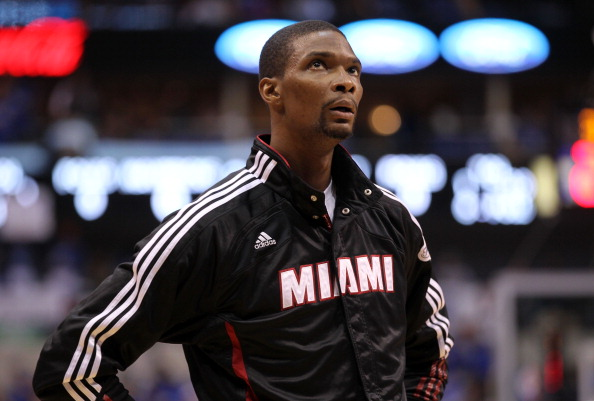 DALLAS, TX - JUNE 09:  Chris Bosh #1 of the Miami Heat looks on before taking on the Dallas Mavericks in Game Five of the 2011 NBA Finals at American Airlines Center on June 9, 2011 in Dallas, Texas.  NOTE TO USER: User expressly acknowledges and agrees that, by downloading and/or using this Photograph, user is consenting to the terms and conditions of the Getty Images License Agreement.  (Photo by Mike Ehrmann/Getty Images)