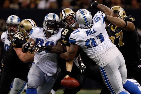 NEW ORLEANS, LA - DECEMBER 04:  Quarterback Drew Brees #9 of the New Orleans Saints is sacked by defensive tackle Sammie Lee Hill #91 of the Detroit Lions at Mercedes-Benz Superdome on December 4, 2011 in New Orleans, Louisiana.  (Photo by Chris Graythen/Getty Images)