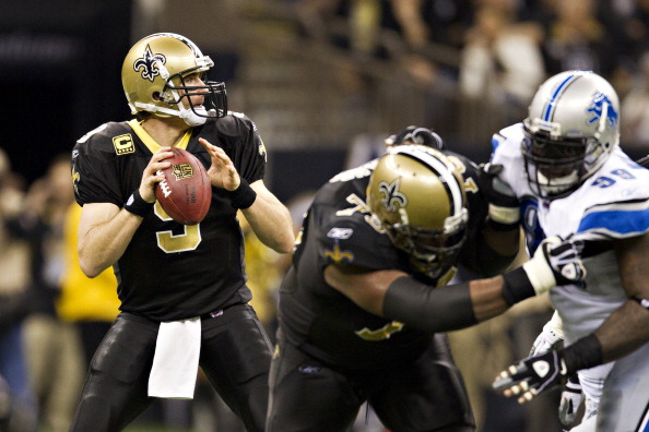 NEW ORLEANS, LA - DECEMBER 4:   Quarterback Drew Brees #8 of the New Orleans Saints drops back to pass against the Detroit Lions at Mercedes-Benz Superdome on December 4, 2011 in New Orleans, Louisiana.  (Photo by Wesley Hitt/Getty Images)