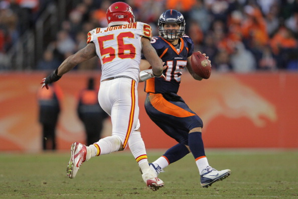 DENVER, CO - JANUARY 01:  Quarterback Tim Tebow #15 of the Denver Broncos scrambles and tries to elude linebacker Derrick Johnson #56 of the Kansas City Chiefs at Sports Authority Field at Mile High on January 1, 2012 in Denver, Colorado.  (Photo by Doug Pensinger/Getty Images)